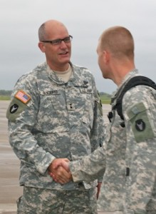 Under overcast skies, a bright day for Minnesota Soldiers and families