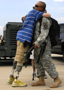 Sgt. John Kriesel (left) hugs his battle buddies as they step off the plane during the final return of the Minnesota National Guard's 1/34th Brigade Red Bulls from Iraq. Photo by Sgt. Joe Roos.