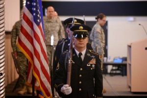 The Minnesota National Guard Honor Guard team acts as a color guard for the posting of the colors during the Minnesota Military Mental Health Initiative conference held on Camp Ripley Apr 15, 2015.